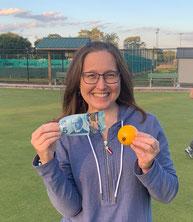 Photo of Jen Newman holding $5 bill and yellow jack.