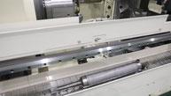 Automatische Entladung einer U-Jin-Tech-Corp-Reibschweißmaschine durch Materialhandhabungssystem