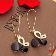 Boucles d'oreilles pendantes papillons noirs et dorés