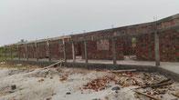 Schulhausbau DYARAMA SCHULE, fertige Mauern