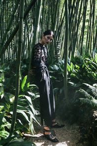 an oriental girl in the jungle