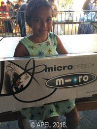 La gagnante du gros lot de la tombola enfant. Photo publiée avec l'autorisation des parents.
