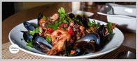 Zum Rezept Frutti di Mare - Meeresfrüchte in Tomaten-Weißweinsosse