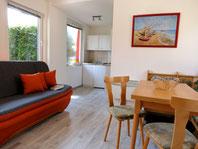 Ferienhaus - Wohnbereich mit Sofa