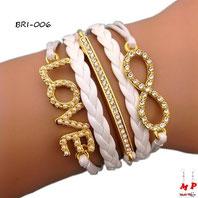Bracelet infini blanc et doré en similicuir breloques love et barre