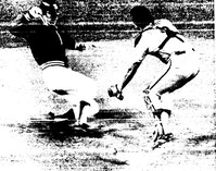 Bob Boone tags out L.A.'s Dave Goltz at home.