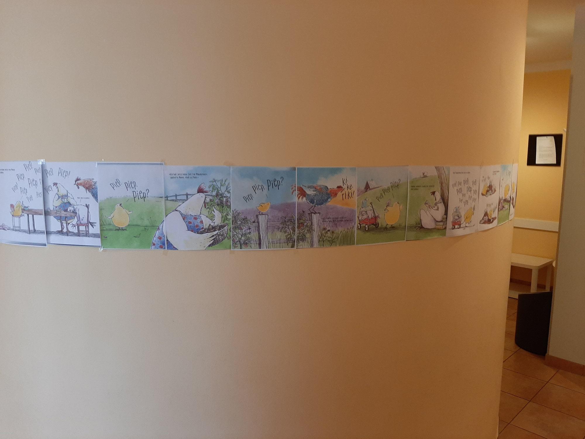 Bilderbuch an der Wand