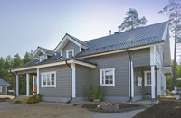 Einfamilienhaus - Blockhaus mit Metaldach in Finnland
