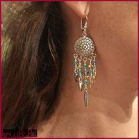 Orecchini con perline turchese/oro con charm a forma di piuma