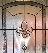 Bathroom stained glass window allows for light and privacy