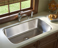 Undermount stainless steel sink installed in a kitchen countertop