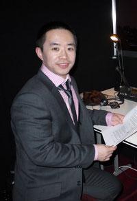 Taking a break during a simultaneous interpreting assignment in Melbourne, Jiang Yu, NAAT certified English<>Chinese/Mandarin translator/interpreter