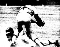 Joe Strain avoids the tag and block of Bob Boone to score.