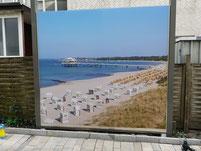 Digitaldruck und Werbefolierung Strand Wrap-expert