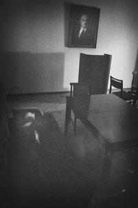 LATVIA / Riga / From the book 'Auftakt'. Man sleeps in a bar with portrait of Lenin on the wall, 2009