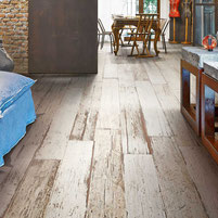 Living room with floor tiles that look like rustic reclaimed white-washed painted barn wood.