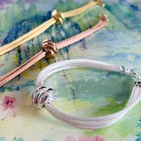 "Bracelet ""Kiss"" with satin silver strands"