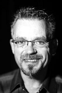 Holger Reuter (Amos Calloway)