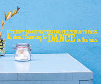 Life isn't about waiting for the storm to pass, it's about leaning to dance in the rain vinyl wall art quote
