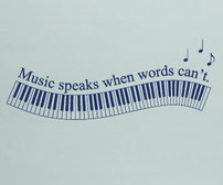 Music Speaks when words can't vinyl decal with an 88 key piano in a wave