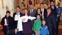 Die in der Schweiz lebende Familie ließ ihr Kind in Ast taufen.