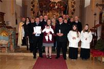 Die Taufgesellschaft mit Annalena und den Eltern Martina und Johann Braun sowie dem Taufpaten Christian Braun.