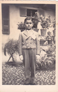 Beppe at 8, dressed for Cresima