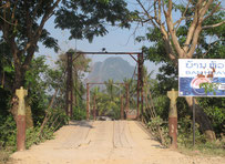 Bridge over a river to a limestone mountain forest in Vang Vieng, Vientiane province, Laos