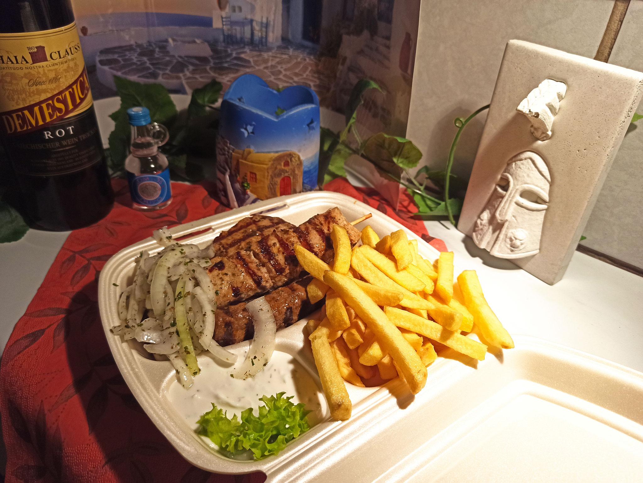 Der Grill-Teller: 4 Sorten Fleisch, Zwiebeln, Zaziki und Pommes oder Reis