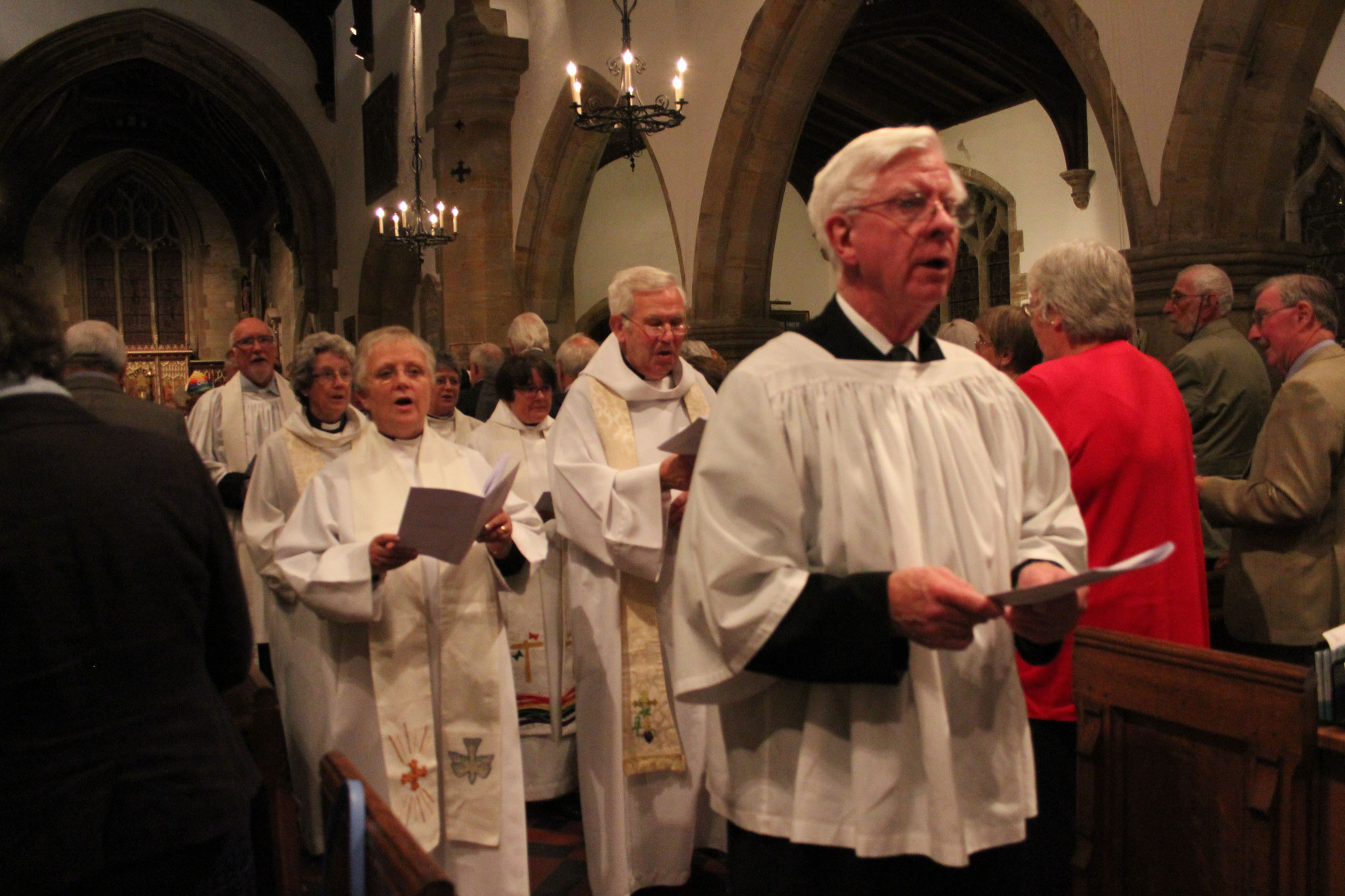 Sacristan Ian Oram and priests