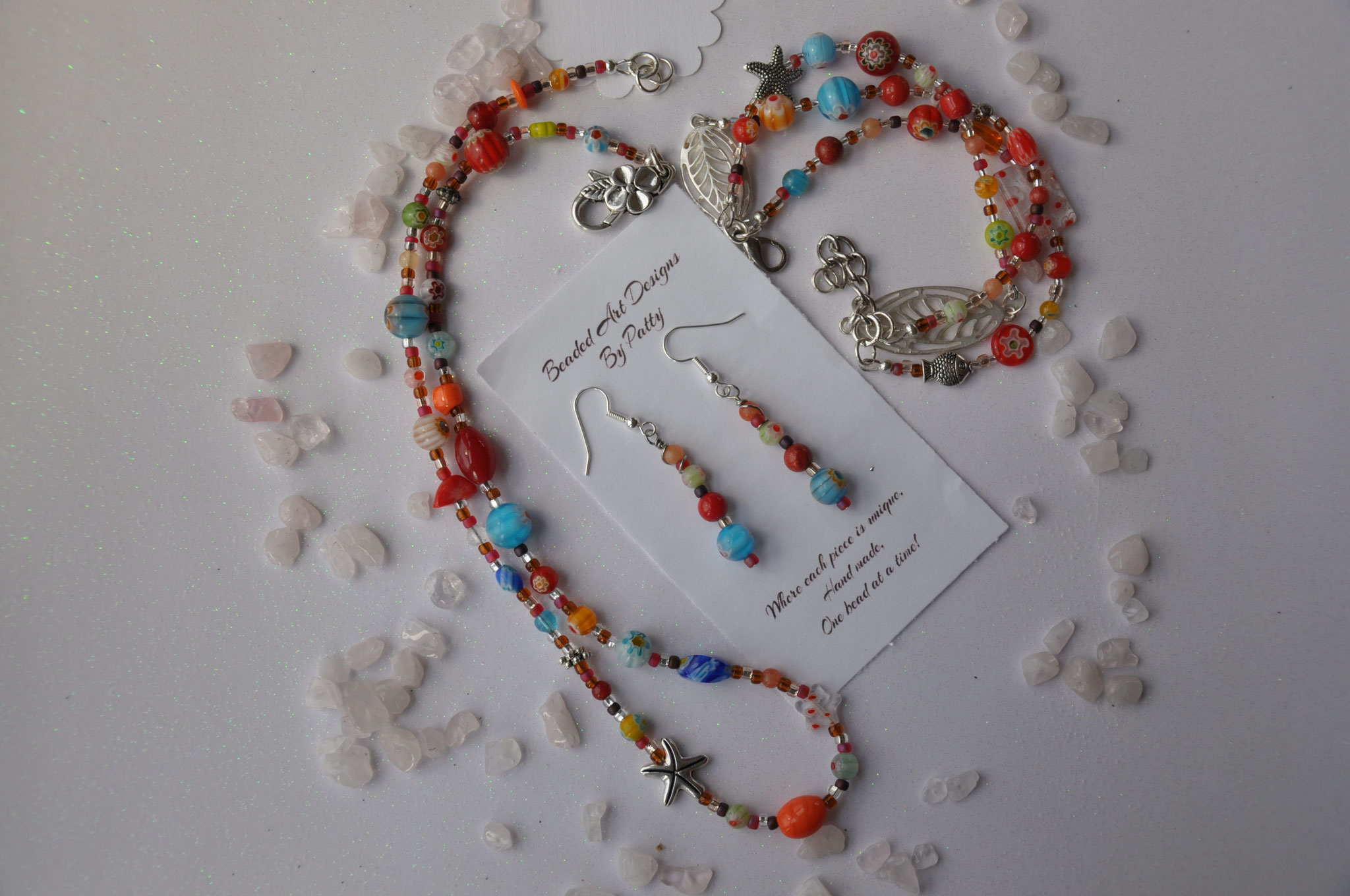 Flowers on the Beach  Beads: Millefiori Glass, seed, Metal and quartzite  adjustable triple wrap bracelet $25.00 ( 6 1/4 to 8 inch wrist)  necklace $25.00 (20 inches)  earrings $15.00