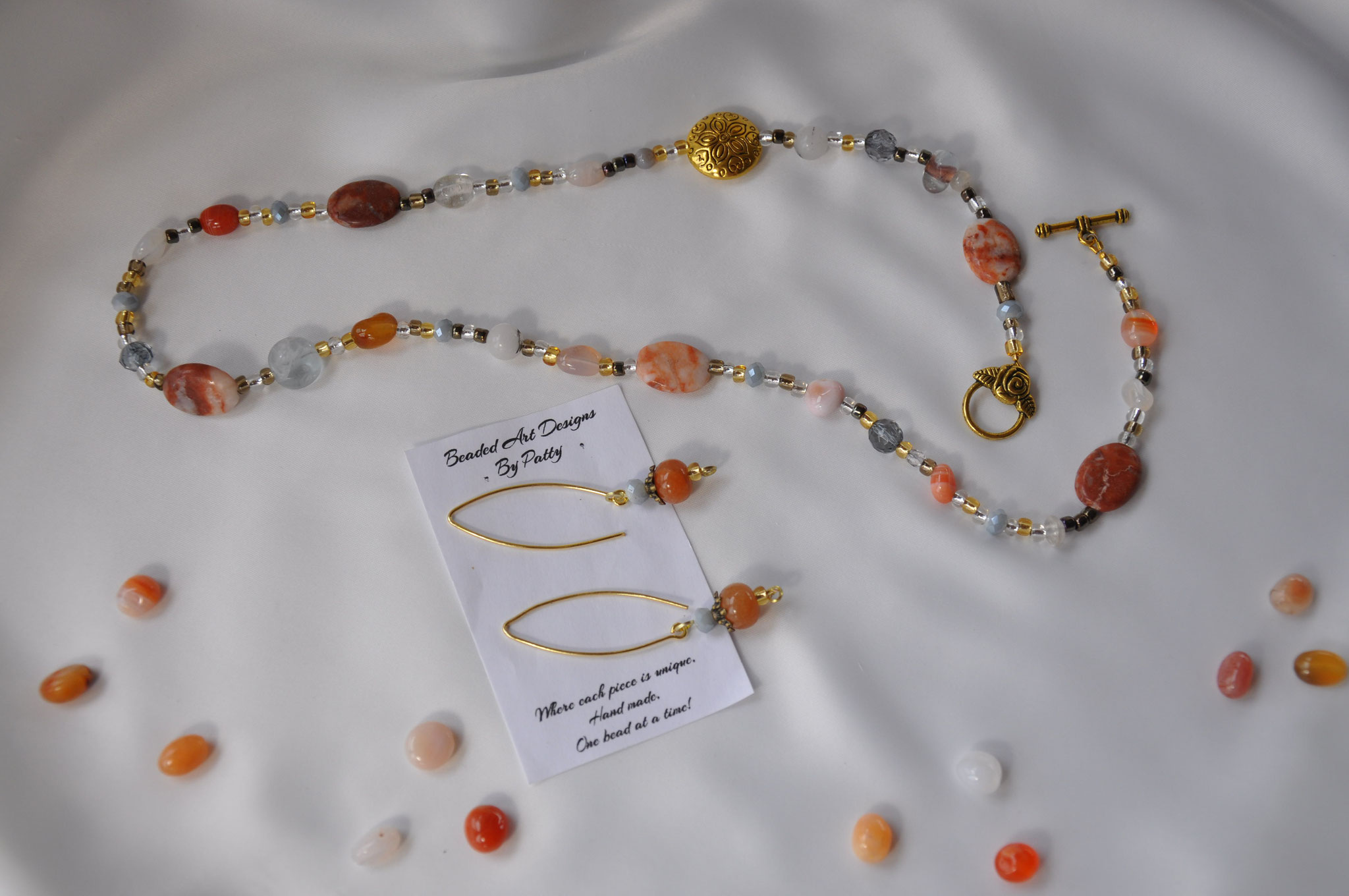 Tangerine Time   Assorted Gemstones, Metal and seed beads  Necklace 24 inches  $45.00  Marching Earring   $20.00