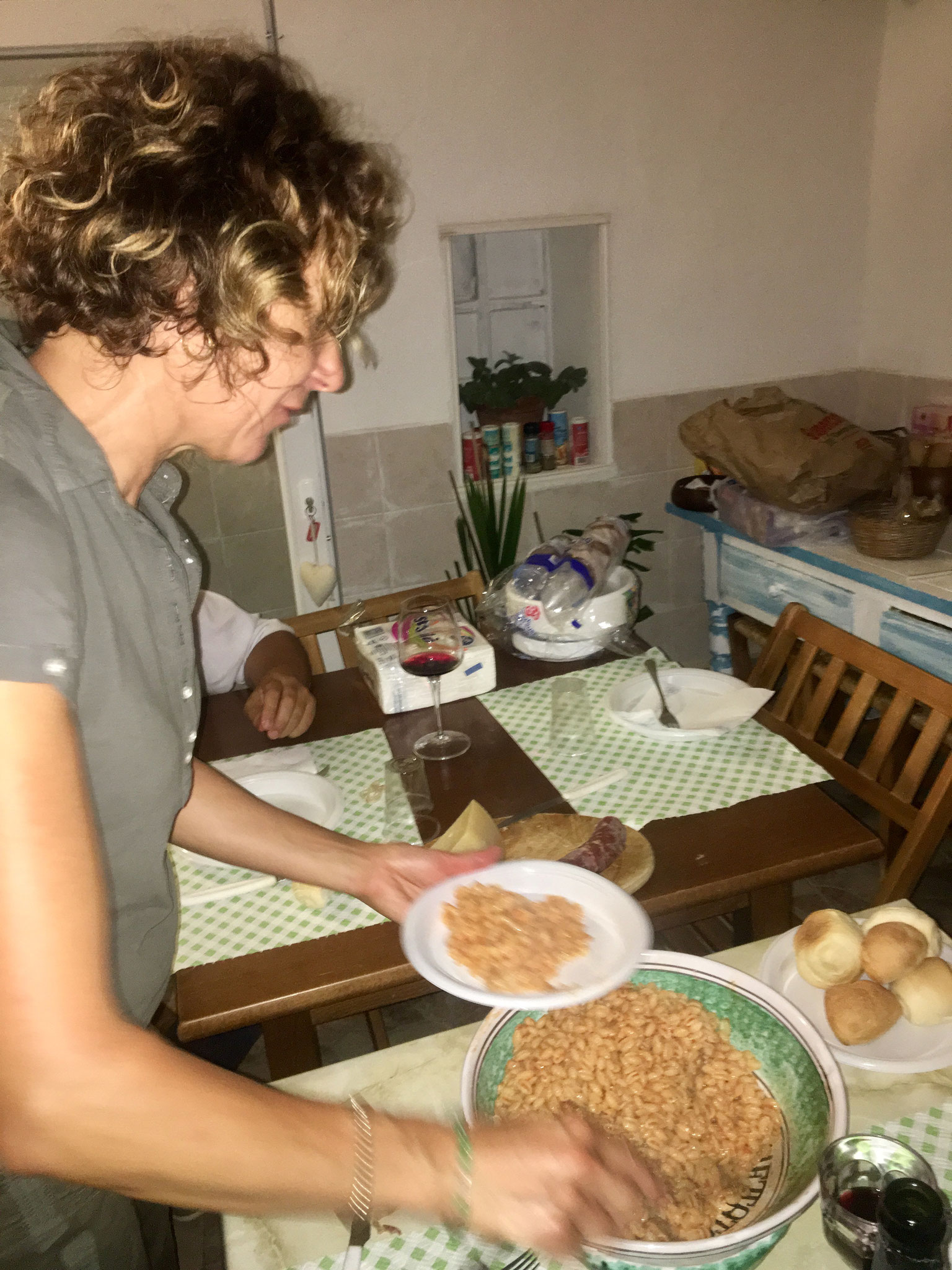Stefania preparing typical sardinian dinner