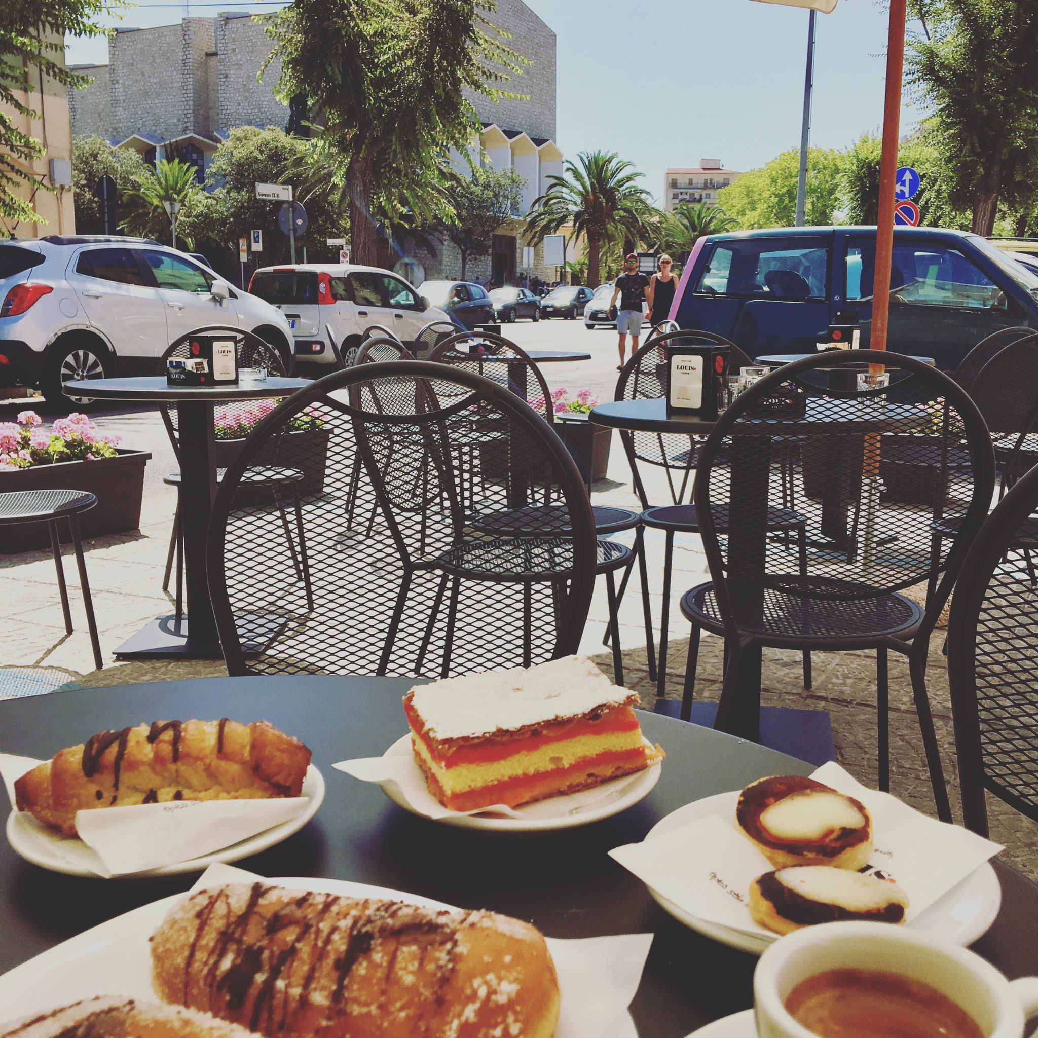 Sip of coffee and piece of cake at Costanzo Caffeteria