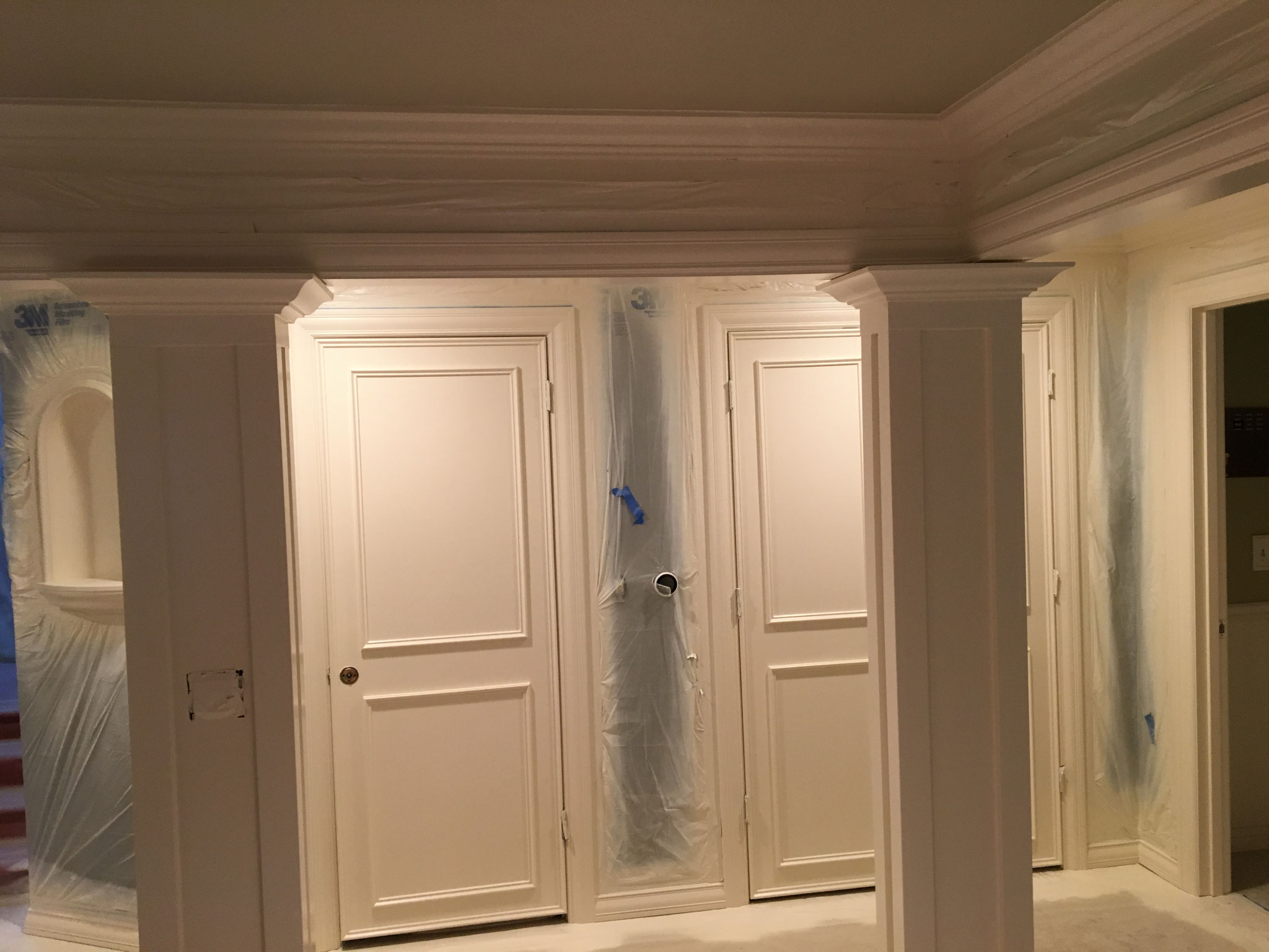 Interior woodwork sprayed fine finish...the walls are protected with plastic.
