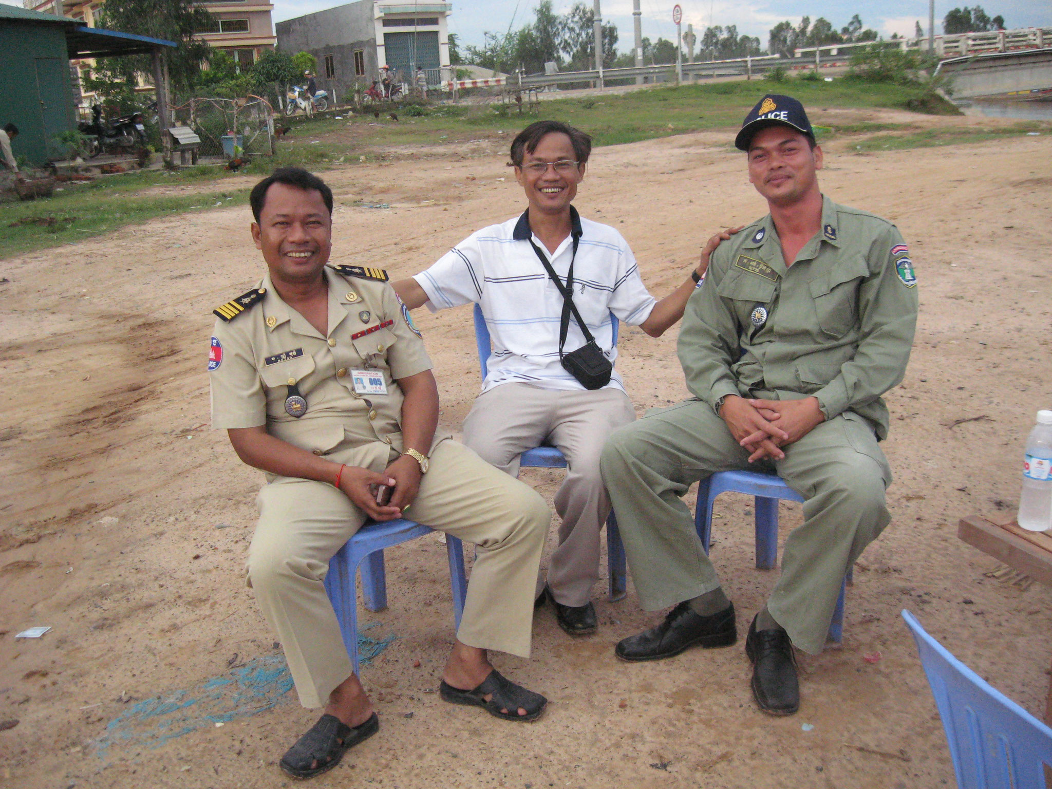 with 2 Cambodian Policemen