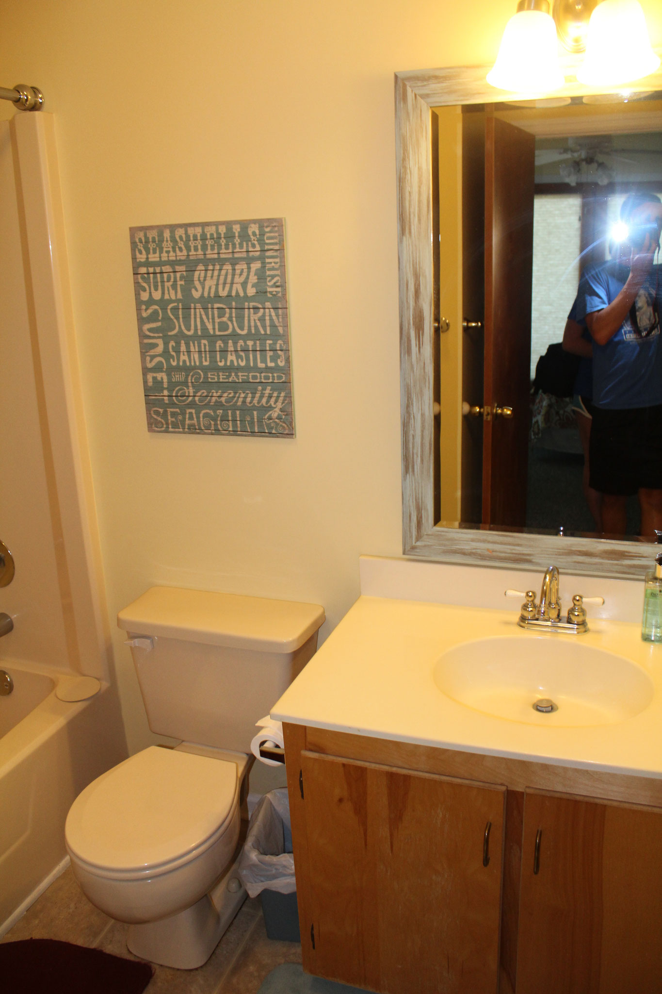 The bathroom attached to the first bedroom is also accessible from the hall.