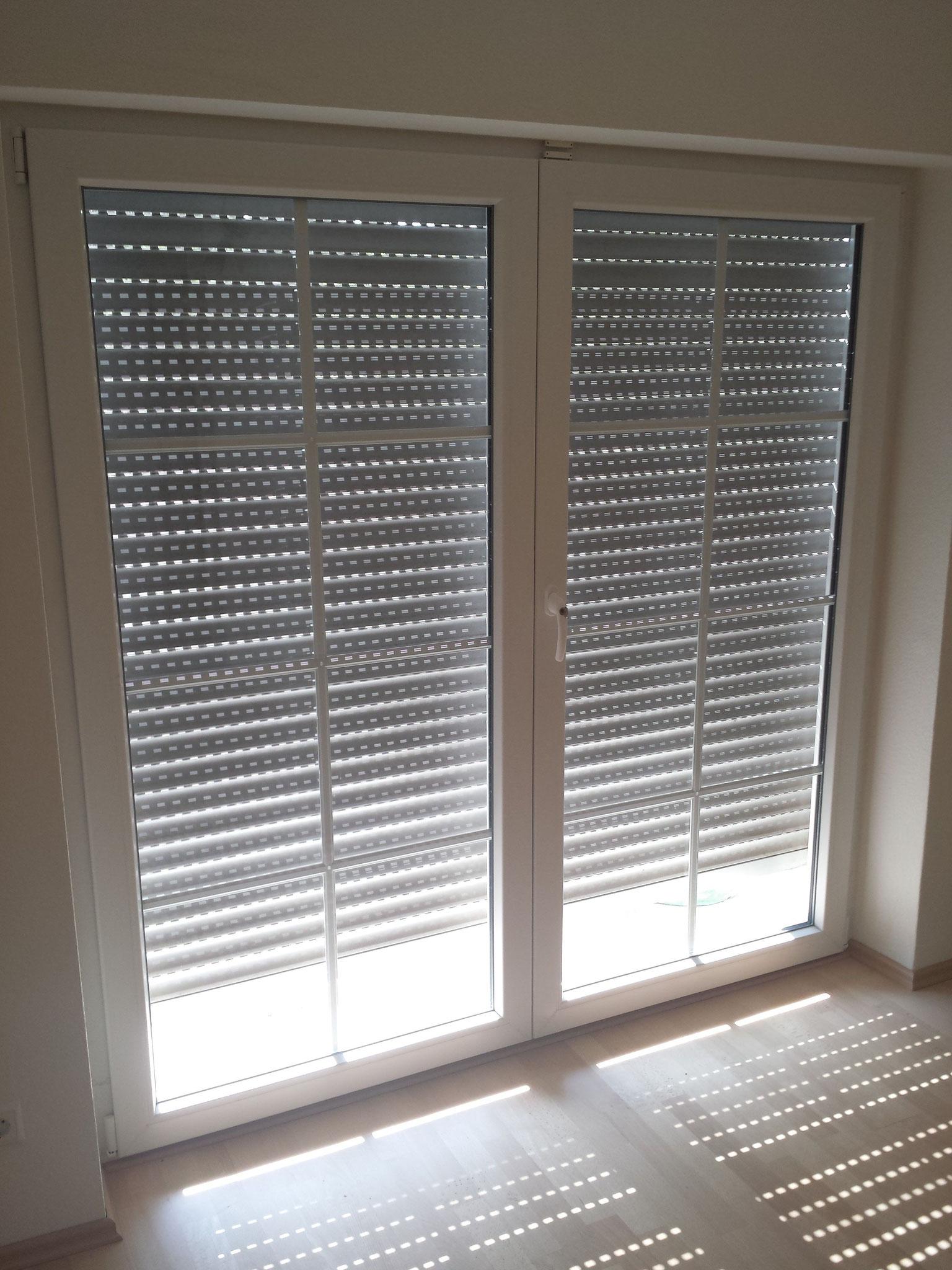 Fenster in Kunststoff und Holz