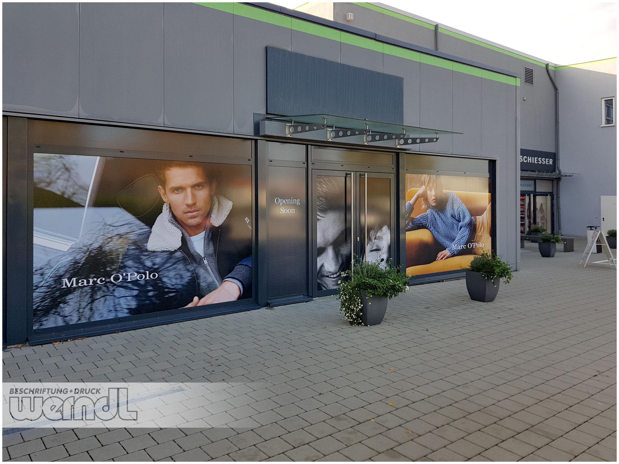 Temporäre Schaufenstergestaltung im Digitaldruck für ein Outlet-Center.