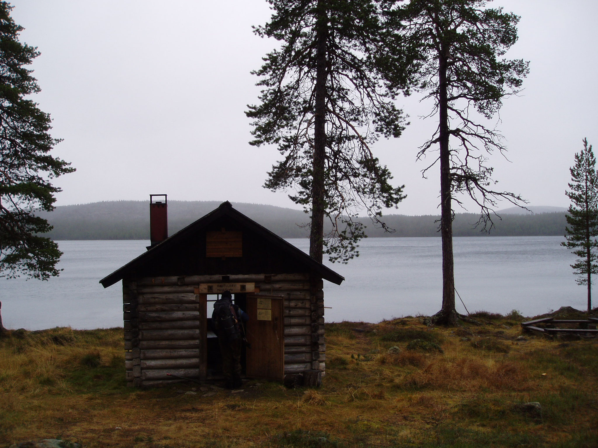 Just another finnish forest hut somewhere in Lapland, by  a lake (Rautujärvi). After a few days hike, those are just the coziest places on Earth.