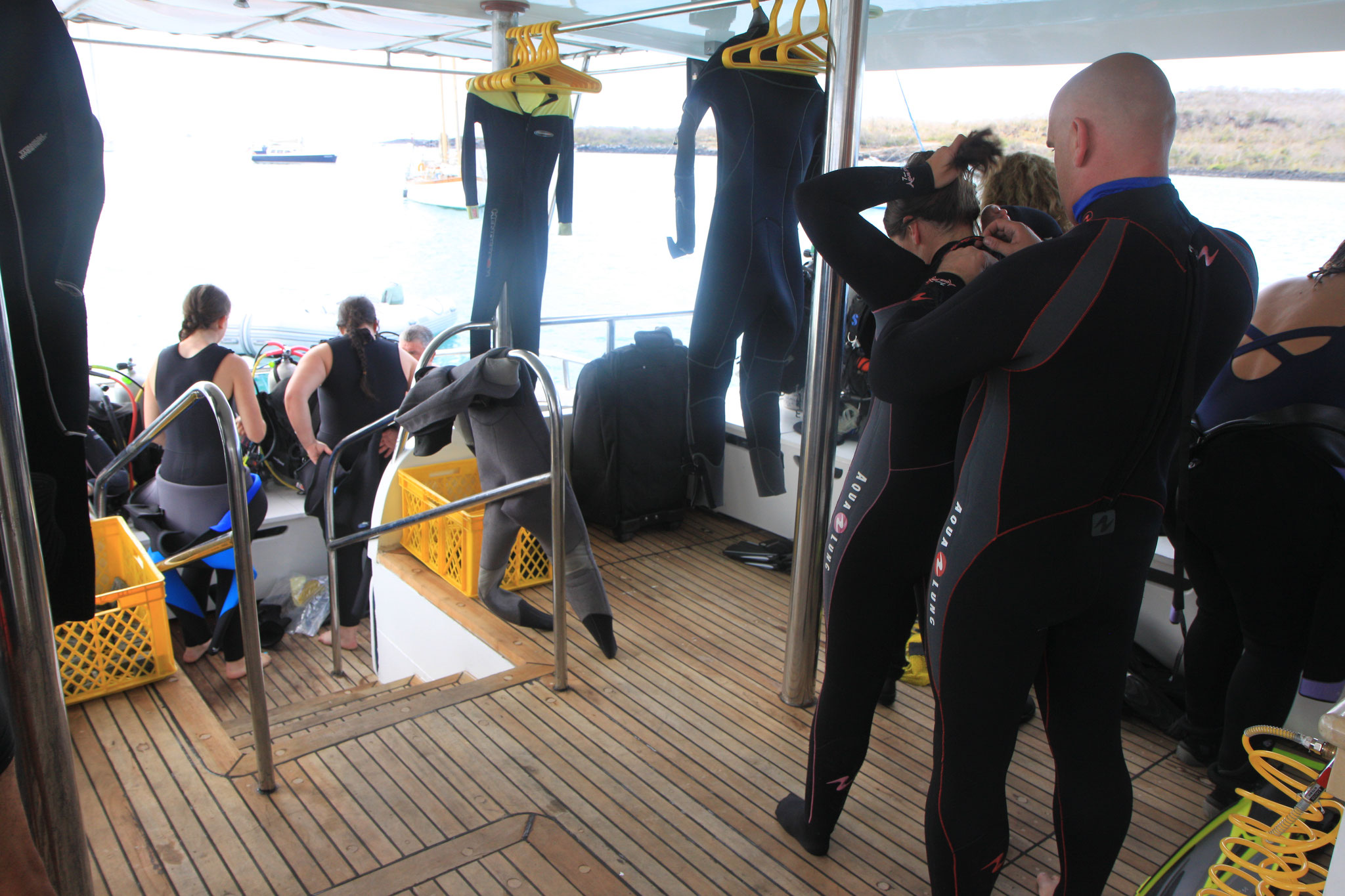 Galapagos Shark Diving - divers getting ready on the dive deck of the ship Galapagos Dive Liveaboard
