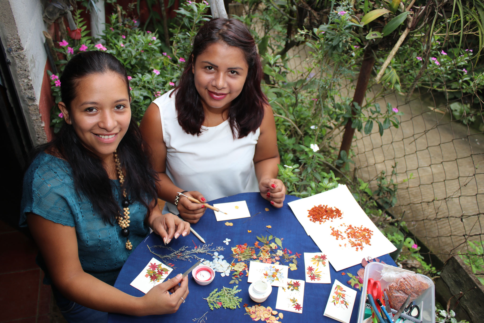 Noelia and Daniela create beautiful cards and pictures with flowers for their company Guanaquitas