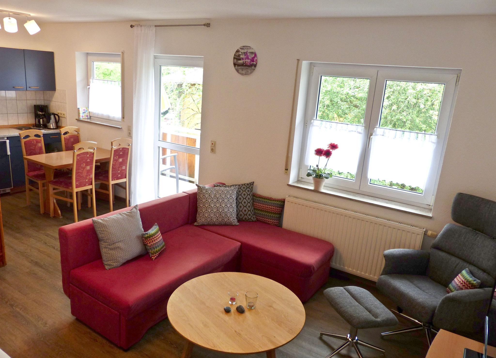Wohnbereich mit ausziehbarer Couch