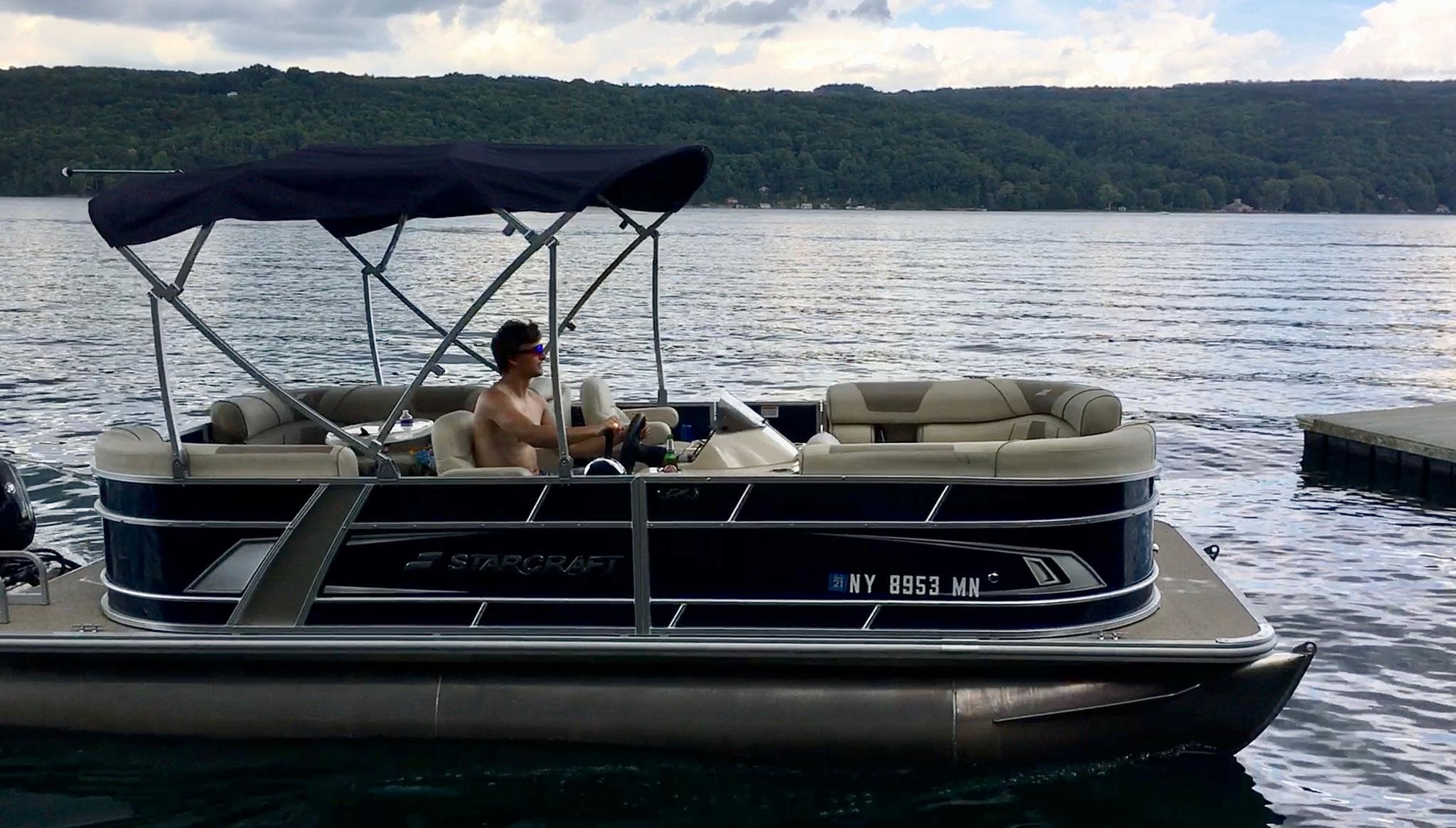 Jack drives the new pontoon boat