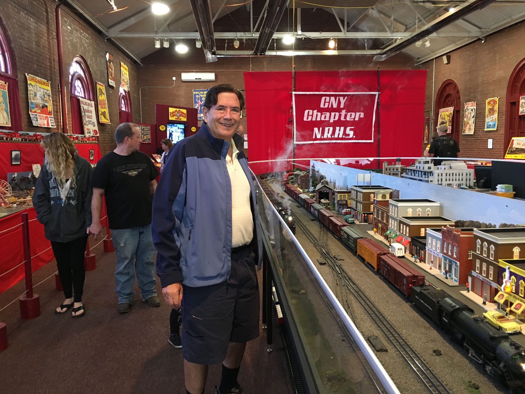 John admires the model trains at the state fair