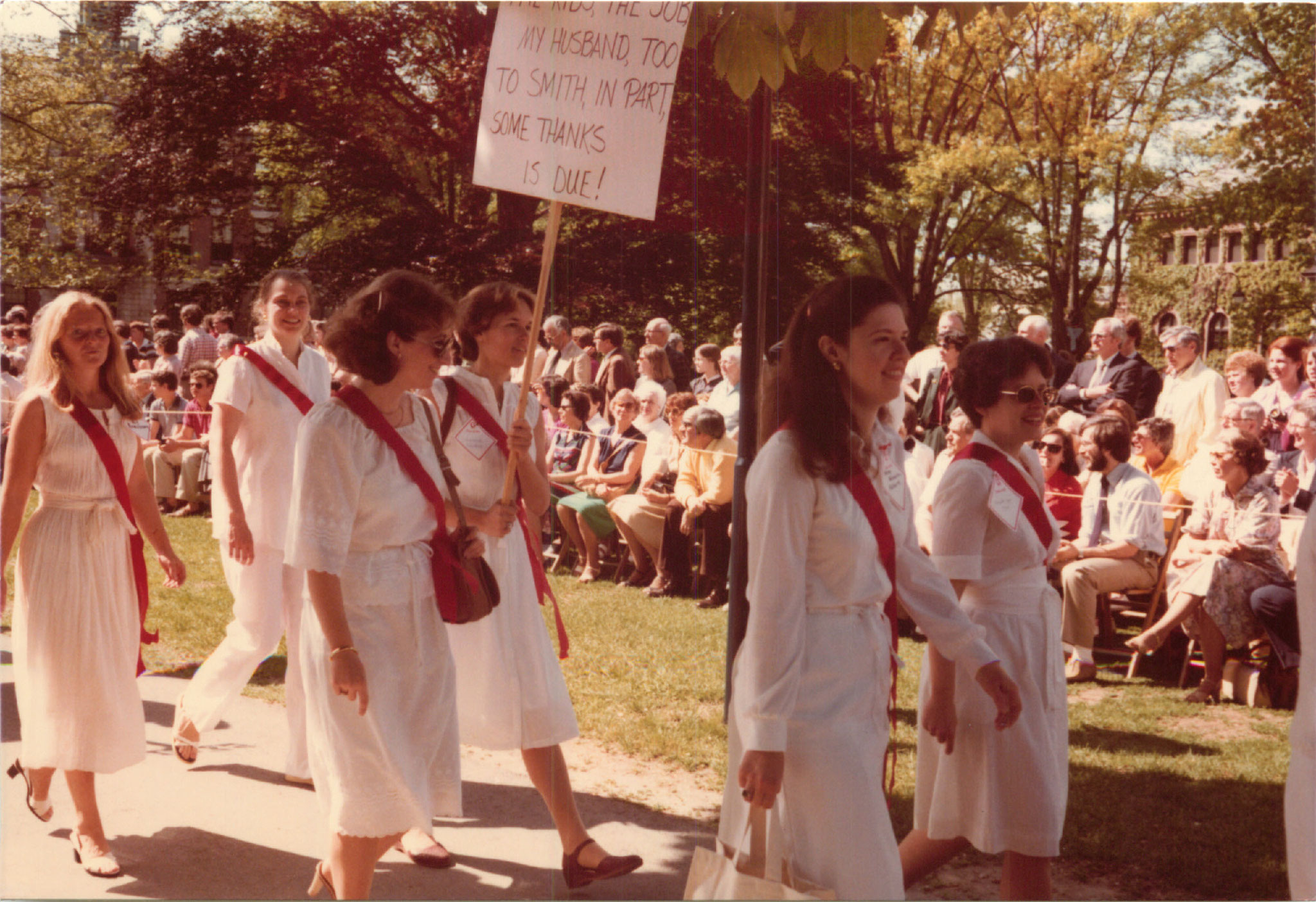 Lorraine holding sign, with Roxanne Horning next to her; in front, Betsy Buzash & Elizabeth Singer Maule