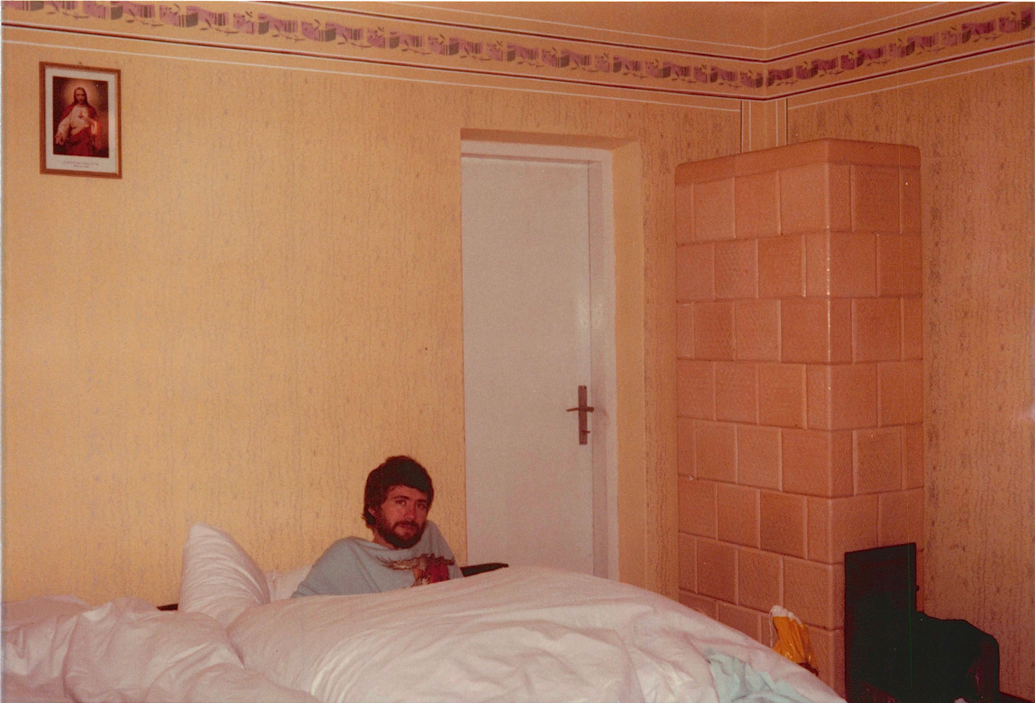 John in the big bed all four of us (Eleanor, Mayme, John & Lorraine) slept in at Genek & Jadwiga's home, with down covers
