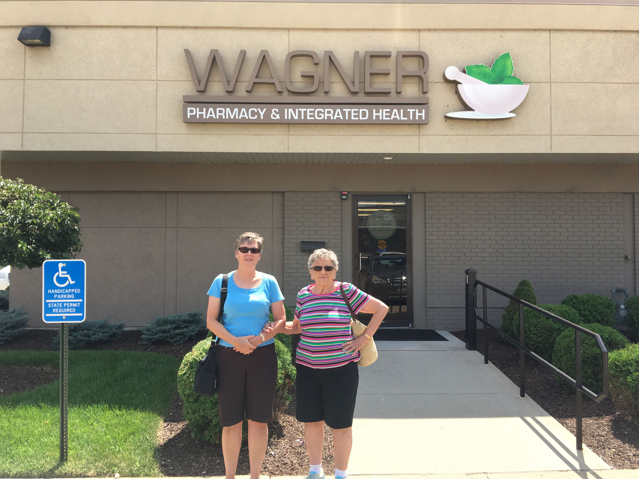 Cindy & Mary Lou in front of Wagner Pharmacy in Clinton, Iowa, started by Cindy's dad, John, and her Uncle Geroge in the 1940s (Aug 2016)
