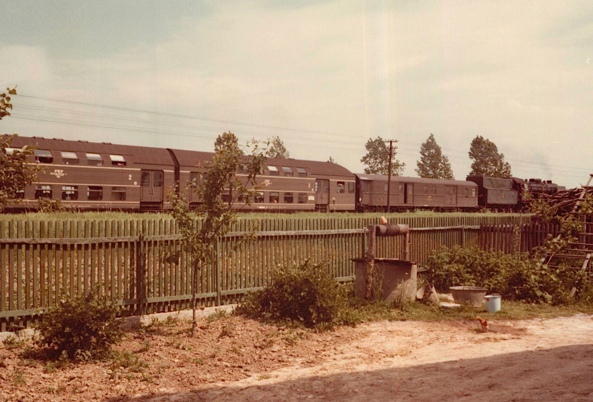 double decker train going by Jadwiga's driveway, 1978