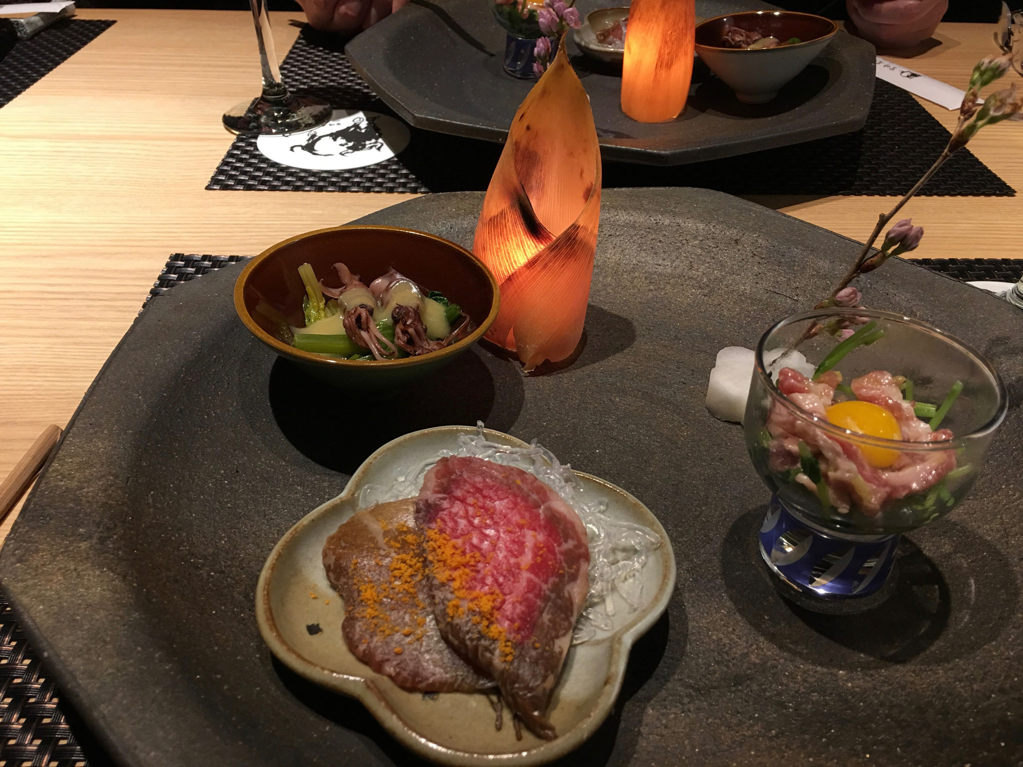 Raw beef, and baby squid at the restaurant.